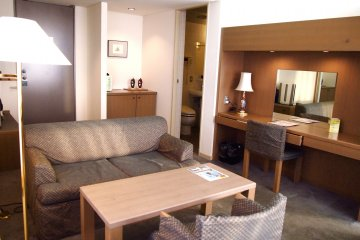 The living room of the spacious hotel suite in Kita hotel.