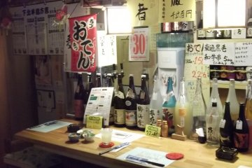 <p>The counter with most of its bottles</p>