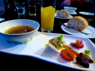 Hors d'oeuvre, soup, bread and beverage