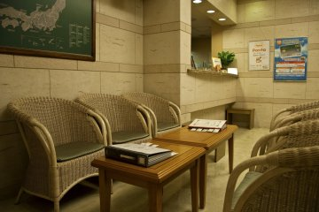 <p>Front desk and rest area in the lobby</p>