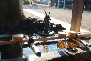 Chōzuya or purification font to clean your hands and rinse your mouth.