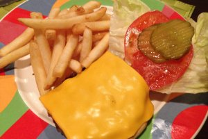 The Okuma Burger is a six ounce all beef patty with melted cheese, French fries and condiments
