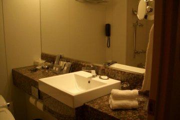 Marble Bathroom in Basic Twin Bed Hotel Room