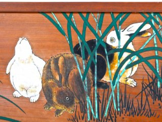 One of the buildings features a series of rabbit paintings on its walls