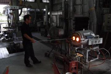 <p>In the glassware factory</p>