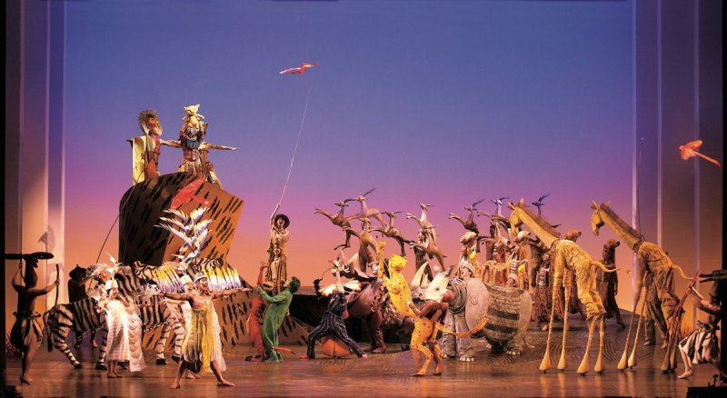 A dynamic stage for a performance of The Lion King.
